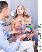 Купить «Smiling mother and father with little son talking», фото № 33814587, снято 27 мая 2017 г. (c) Яков Филимонов / Фотобанк Лори