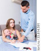 Купить «Gloomy female signing documents», фото № 33814591, снято 27 мая 2017 г. (c) Яков Филимонов / Фотобанк Лори
