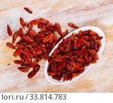 Купить «Dried cayenne peppers in bowl», фото № 33814783, снято 25 мая 2020 г. (c) Яков Филимонов / Фотобанк Лори