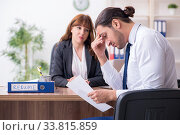 Купить «Business meeting between businessman and businesswoman», фото № 33815859, снято 9 октября 2019 г. (c) Elnur / Фотобанк Лори