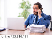 Young male businessman working in the office. Стоковое фото, фотограф Elnur / Фотобанк Лори