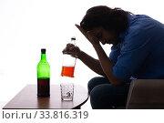 Купить «Young man suffering from alcoholism», фото № 33816319, снято 10 сентября 2019 г. (c) Elnur / Фотобанк Лори