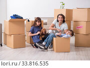 Купить «Young family moving to new flat», фото № 33816535, снято 28 июня 2019 г. (c) Elnur / Фотобанк Лори
