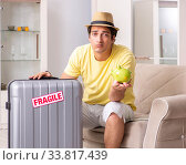 Man going on vacation with fragile suitcases. Стоковое фото, фотограф Elnur / Фотобанк Лори