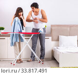 Купить «Young woman doing ironing for her husband», фото № 33817491, снято 27 июня 2018 г. (c) Elnur / Фотобанк Лори