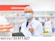 Купить «old apothecary in mask with tablet pc at pharmacy», фото № 33817827, снято 27 июня 2015 г. (c) Syda Productions / Фотобанк Лори