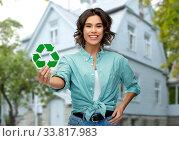 Купить «smiling young woman holding green recycling sign», фото № 33817983, снято 18 апреля 2020 г. (c) Syda Productions / Фотобанк Лори