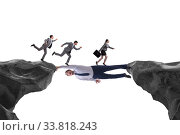 Купить «Businessman acting as a bridge in support concept», фото № 33818243, снято 21 мая 2020 г. (c) Elnur / Фотобанк Лори