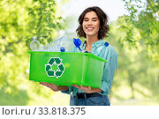 Купить «smiling young woman sorting plastic waste», фото № 33818375, снято 18 апреля 2020 г. (c) Syda Productions / Фотобанк Лори
