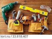 Купить «different work tools on wooden boards», фото № 33818407, снято 26 ноября 2019 г. (c) Syda Productions / Фотобанк Лори