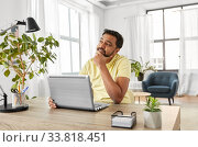 Купить «indian man with laptop working at home office», фото № 33818451, снято 4 апреля 2020 г. (c) Syda Productions / Фотобанк Лори
