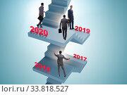 Купить «Businessman climbing stairs on yearly basis», фото № 33818527, снято 4 июня 2020 г. (c) Elnur / Фотобанк Лори