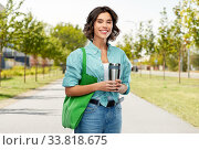 Купить «woman with bag for food shopping and tumbler», фото № 33818675, снято 18 апреля 2020 г. (c) Syda Productions / Фотобанк Лори
