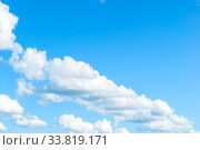 Купить «Blue sky background. Picturesque colorful clouds lit by sunlight. Vast sky landscape panoramic view», фото № 33819171, снято 16 августа 2019 г. (c) Зезелина Марина / Фотобанк Лори