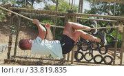 Купить «Caucasian male coach training at a boot camp», видеоролик № 33819835, снято 7 февраля 2020 г. (c) Wavebreak Media / Фотобанк Лори