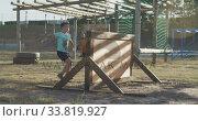 Купить «Caucasian boy training at boot camp », видеоролик № 33819927, снято 7 февраля 2020 г. (c) Wavebreak Media / Фотобанк Лори