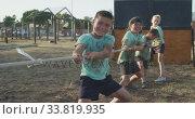 Купить «Group of Caucasian children training at boot camp », видеоролик № 33819935, снято 7 февраля 2020 г. (c) Wavebreak Media / Фотобанк Лори