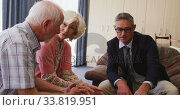 Senior couple talking with a business man in retirement house. Стоковое видео, агентство Wavebreak Media / Фотобанк Лори