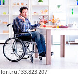 Купить «The young disabled husband preparing food salad», фото № 33823207, снято 25 мая 2020 г. (c) easy Fotostock / Фотобанк Лори