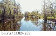 Купить «View of dirty river between the field», видеоролик № 33824255, снято 2 июня 2020 г. (c) Константин Шишкин / Фотобанк Лори