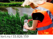 Купить «Take samples of water for laboratory testing. The concept - analysis of water purity, environment, ecology», фото № 33826159, снято 14 июля 2020 г. (c) easy Fotostock / Фотобанк Лори