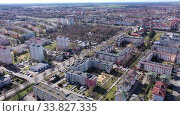 Купить «Aerial view of modern residential areas of Polish city of Leszno in sunny spring day», видеоролик № 33827335, снято 14 марта 2020 г. (c) Яков Филимонов / Фотобанк Лори