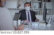 Office workers in protective medical masks work at the computer. Стоковое видео, видеограф Яков Филимонов / Фотобанк Лори