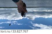 Купить «Mans hand with automatic gun pistol close-up. Shooting to blue sky», видеоролик № 33827767, снято 20 мая 2020 г. (c) Константин Шишкин / Фотобанк Лори