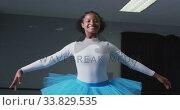 Купить «Mixed race female ballerina  dancing in a dance studio», видеоролик № 33829535, снято 4 декабря 2019 г. (c) Wavebreak Media / Фотобанк Лори