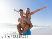 Купить «Caucasian couple enjoying time at the beach», фото № 33829731, снято 25 февраля 2020 г. (c) Wavebreak Media / Фотобанк Лори