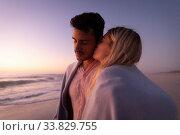 Купить «Caucasian couple enjoying time at the beach during the sunset», фото № 33829755, снято 25 февраля 2020 г. (c) Wavebreak Media / Фотобанк Лори