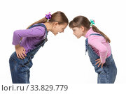 Купить «Girl yells at younger sister during altercation on white background», фото № 33829779, снято 15 мая 2020 г. (c) Иванов Алексей / Фотобанк Лори