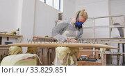 Купить «Caucasian male surfboard maker wearing a face mask and polishing a surfboard», видеоролик № 33829851, снято 6 марта 2020 г. (c) Wavebreak Media / Фотобанк Лори