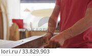Купить «Caucasian male surfboard maker working in his studio and making a wooden surfboard», видеоролик № 33829903, снято 6 марта 2020 г. (c) Wavebreak Media / Фотобанк Лори