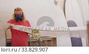 Купить «Caucasian male surfboard maker wearing a face mask and making a surfboard», видеоролик № 33829907, снято 6 марта 2020 г. (c) Wavebreak Media / Фотобанк Лори