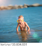 Купить «Little boy with snorkel by the sea. Cute little kid wearing mask and flippers for diving at sand tropical beach. Ocean coast.», фото № 33834031, снято 3 июля 2020 г. (c) easy Fotostock / Фотобанк Лори