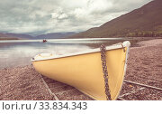 Купить «Boat on lake in mountains. Autumn season.», фото № 33834343, снято 25 мая 2020 г. (c) easy Fotostock / Фотобанк Лори