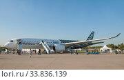 Купить «Пассажирский двухдвигательный широкофюзеляжный самолёт Airbus A350-900 XWB с регистрационным номером F-WWCF на Международном авиасалоне МАКС-2019 в Жуковском, Россия», фото № 33836139, снято 29 августа 2019 г. (c) Малышев Андрей / Фотобанк Лори