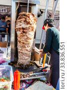 Купить «Traditional fast food doner kebab meat on a rotary grill», фото № 33836551, снято 5 октября 2019 г. (c) FotograFF / Фотобанк Лори
