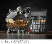 Купить «Savings, investment, credit calculator and accounting financial concept. Piggybank with calculator.», фото № 33837335, снято 12 июля 2020 г. (c) Maksym Yemelyanov / Фотобанк Лори
