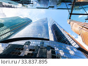Купить «Moscow, Russia - July 9, 2019: Skyscrapers of Moscow City complex. Moscow International Business Center. Modern buildings in Moscow», фото № 33837895, снято 9 июля 2019 г. (c) FotograFF / Фотобанк Лори