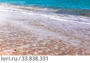 Купить «Foamy surf on a sandy tropical beach», фото № 33838331, снято 24 сентября 2019 г. (c) Евгений Ткачёв / Фотобанк Лори