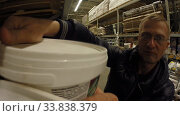 Ufa, Russia - July 29, 2014: A man is shopping in the Hardware department of the Castorama shop. Редакционное видео, видеограф Mikhail Erguine / Фотобанк Лори