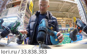 Купить «Ufa, Russia - July 29, 2014: A man is shopping in the Hardware department of the Castorama shop», видеоролик № 33838383, снято 29 июля 2014 г. (c) Mikhail Erguine / Фотобанк Лори