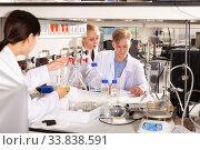 Купить «Student with female coursemates recording results of experiments», фото № 33838591, снято 2 июля 2020 г. (c) Яков Филимонов / Фотобанк Лори