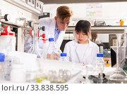Купить «Students engaged in research at lab», фото № 33838595, снято 2 июля 2020 г. (c) Яков Филимонов / Фотобанк Лори