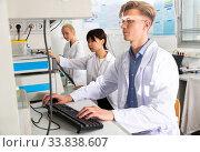 Купить «Students engaged in research at lab», фото № 33838607, снято 2 июля 2020 г. (c) Яков Филимонов / Фотобанк Лори