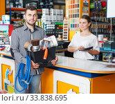 Купить «Man with purchases in household store», фото № 33838695, снято 17 мая 2018 г. (c) Яков Филимонов / Фотобанк Лори