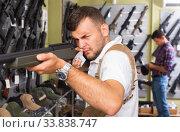 Купить «Man choice pneumatic gun», фото № 33838747, снято 4 июля 2017 г. (c) Яков Филимонов / Фотобанк Лори