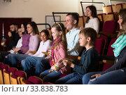 People watching funny movie. Стоковое фото, фотограф Яков Филимонов / Фотобанк Лори